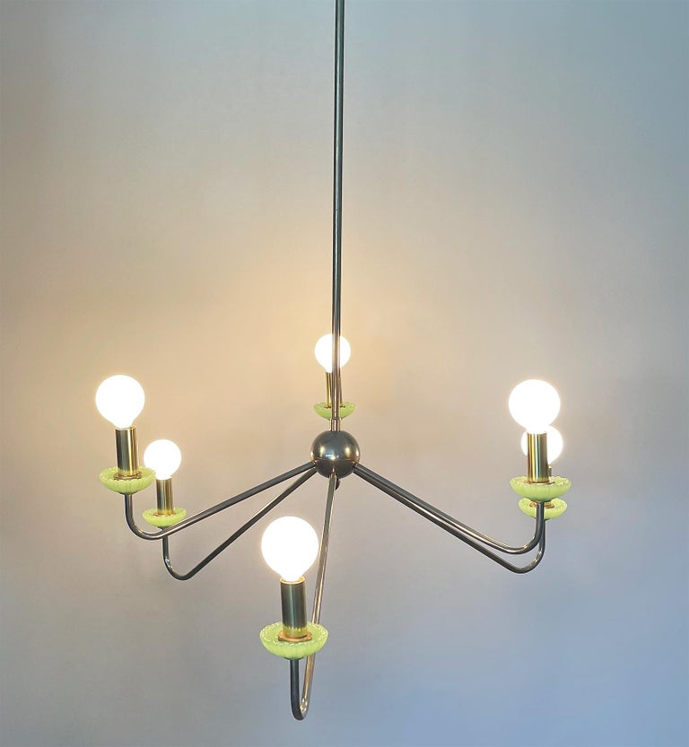 Pair of brass chandelier, Robert Caillat, circa 1955. From a set of ten with six lights. Fully rewired to be used in US. Candelabra sockets with brass hardware. This pair comes with green Murano glass bobeches. Measures: Height 33