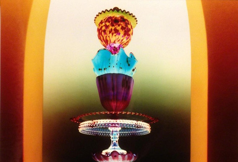 Untitled - Still life tower of glass w/ jewel tone colors in yellow archway - Photograph by Robert Calafiore