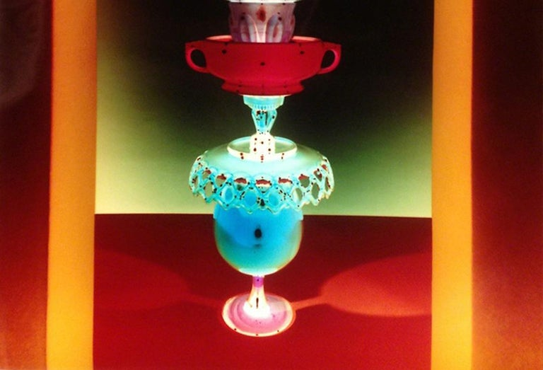 Untitled - Still life tower of glass w/ jewel tone colors in yellow archway - Contemporary Photograph by Robert Calafiore