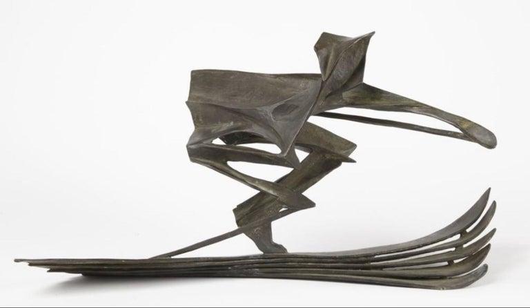 Bronze Sculpture of a Skier  - Gold Figurative Sculpture by Robert Cook