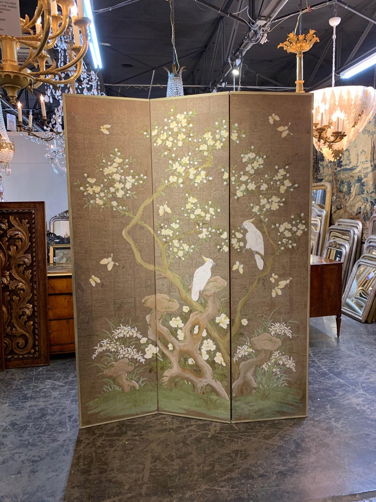 Splendid hand painted 3 panel screen by artist Robert Crowder. Beautiful images of flowers, birds and butterflies. Truly adds interest a fine home. So pretty! Note: There is a small tear on one of the screens that could be repaired.