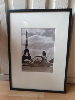 """Robert Doisneau Paul Arzens' """"Electric Egg"""" in front of the Eiffel Tower"""