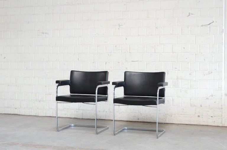 Robert Haussmann RH 305 armchair design of 1957 and manufactured by De Sede. Black semi aniline leather and a chrome steel frame. This is a Classic Swiss design chair. Great condition. Price for 1 chair We have 2 chairs in store.