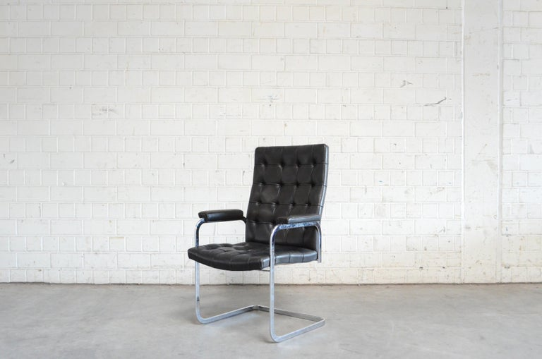 Robert Haussmann RH 305 armchair design of 1957 and manufactured by De Sede. Black aniline leather an a chrome steel frame. This is a Classic Swiss design chair in the tufted highback version. Great condition. Price for 1 Chair.