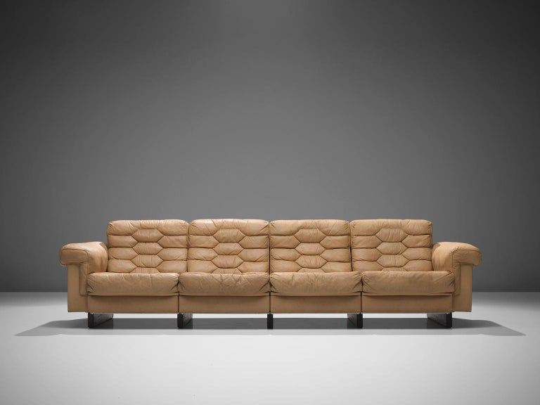 Robert Haussmann for De Sede, DS-P sofa, bright brown leather, 1960s  This sofa is designed by Robert Haussmann for De Sede. The pieces define themselves by honeycomb shaped tufted sections that are visible on seats and backs.The leather of this