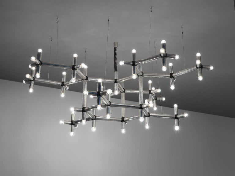 Robert Haussmann, chandelier, polished steel with 70 bulbs, Europe, 1970s.  This beautiful chandelier is executed in chromed steel and features a frame that spreads out as if it were a natural entity. The frame consists of multiple branches that