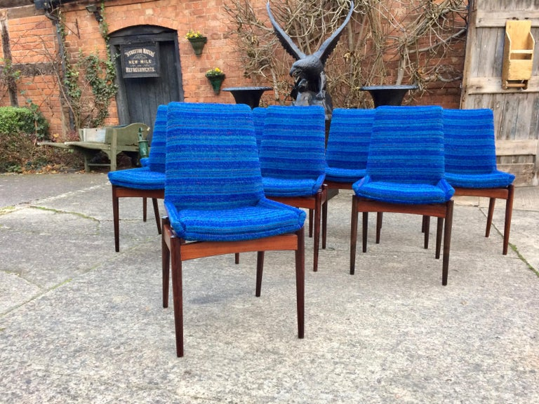 Midcentury Hamilton rosewood dining chairs designed by Robert Heritage and manufactured by Archie Shine and retailed through Heals of London UK, England, circa 1960, 8 dining chairs 6 chairs and 2 carvers 8 in total, finished in original blue fabric