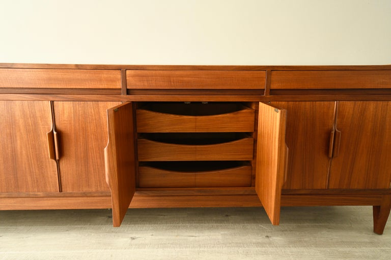 Description  Teak sideboard boasts a Classic midcentury design by Robert Heritage for Archie Shine. Manufactured in the UK around 1960, this piece is still in excellent condition and eager to smarten up a hallway, entrance way or main living