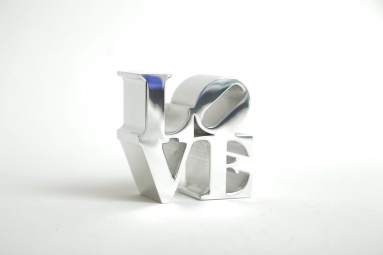 This authentic Robert Indiana chrome LOVE paperweight sculpture is vintage from the 1970s. This will make a great desk accessory. These were at one time sold in museum stores at that time such as MOMA and various other high end museum shops and