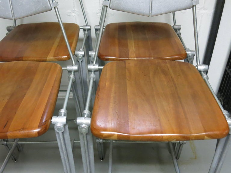 Nice set of 4 Robert Josten cast aluminum and maple bar stools.   A modern industrial style stool from the California designer dating from the 80's.  Seats are at a custom height of 27