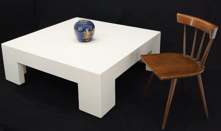 Ultra modern midcentury influence Californian artist large square white enamel lacquer coffee table. Thick white enamel composite like finish.