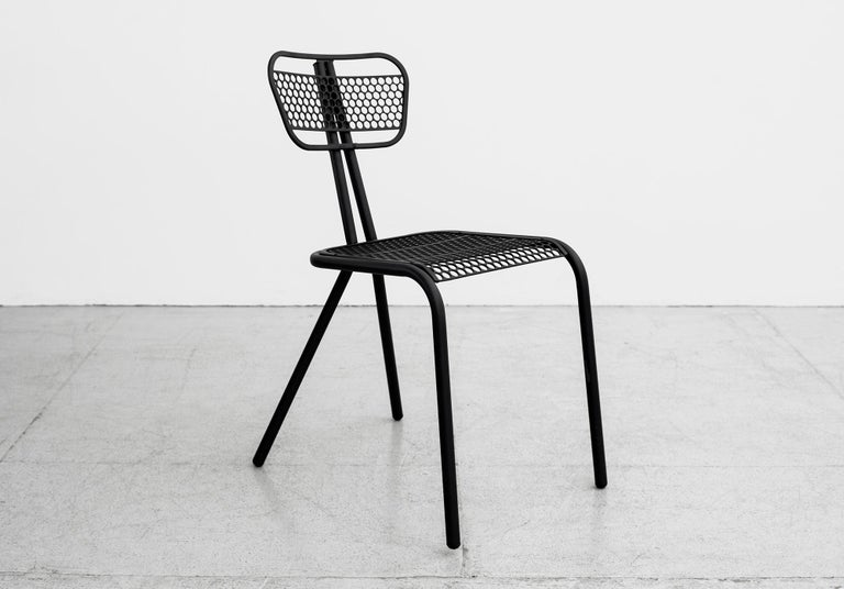 Rare set of four perforated steel chairs by Rene Malaval for Bloc Metal. Post war French with tubular steel legs, in the manner of Jean Prouve Refinished in matte black.