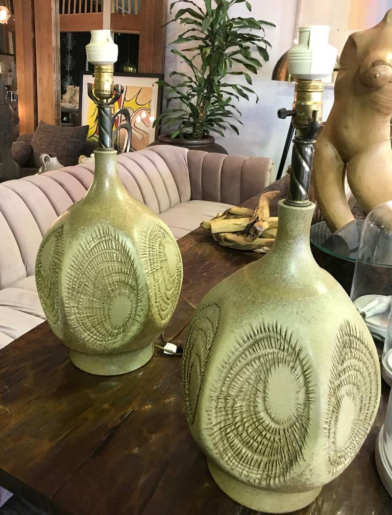 Pair of riveting, handmade lamps with classic incised sunburst pattern by iconic American/Californian potter Robert Maxwell.   Exceptionally rare size and design. Both lamps are in pristine vintage condition. A Fine and scarce example California