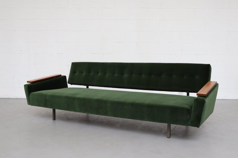 Stylish sofa with square tubular metal frame and teak arms. The sofa seat slides out to a flat bed! Frame is original with signs of wear consistent with age and use, armrests are in good original condition, the sofa is newly re-upholstered in