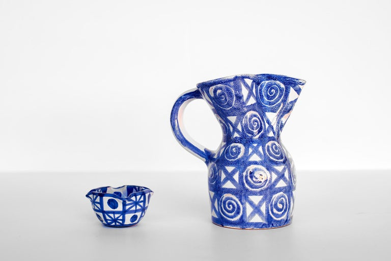 Ceramic pitcher and matching cup by Robert Picault, Vallauris circa 1950 Rare blue pattern.