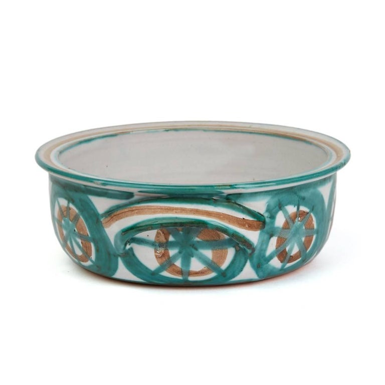 A rare and important stunning French art pottery handled serving bowl by Robert Picault and made in Vallauris in the South of France. Working closely to Picasso each piece is hand decorated with green, brown and incised patterned designs along with