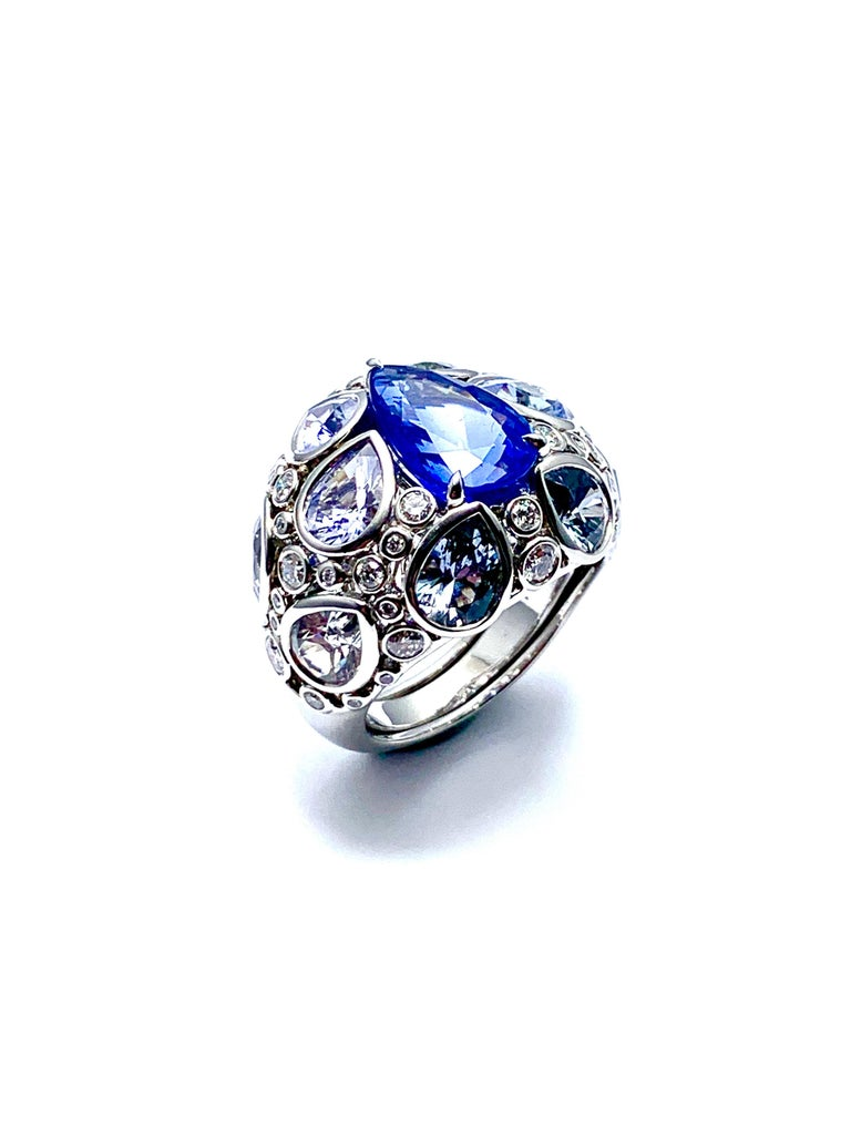 An absolutely gorgeous Robert Procop De La Vie Collection cocktail ring! The ring is handcrafted in platinum with a stunning 4.58 carat pear shape sapphire set with light blue pear shape sapphires, and round brilliant diamonds. There are 10  light