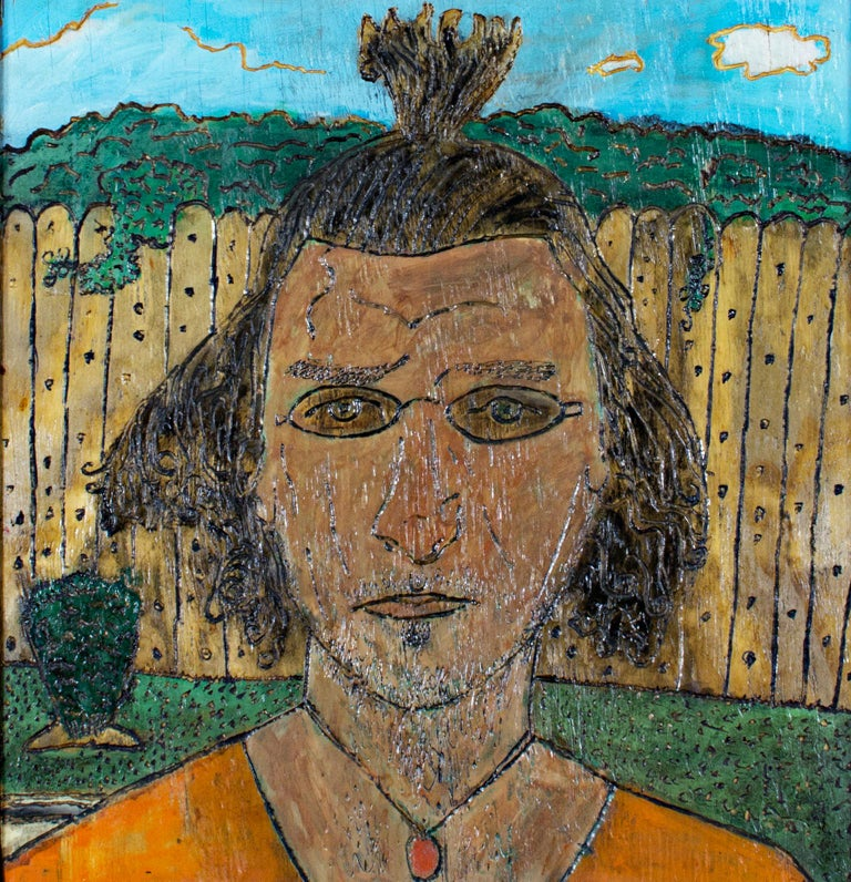 """""""Self Portrait"""" is an original oil painting on wood by Wisconsin artist Robert Richter. The artist signed the piece on the back, and hand-carved the frame so it becomes an integral part of the artwork. The artist's self portrait takes up most of the"""