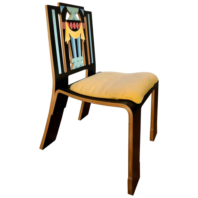 American, black laminate on wood substrate with decal decoration and yellow wool seat cushion, for Knoll Furniture, circa 1984. This witty play on classical form is one of the icons of Postmodernist furniture design.
