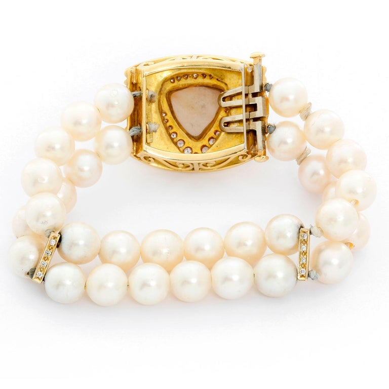 Robert Whiteside Diamond and Cultured Pearl Gold Bracelet - Robert Whiteside Diamond and Cultured Pearl Gold Bracelet  - a double row of 32 pearls on the bracelet measure 8.55mm - 9.20mm.  The braceletis accented with a Mabe pearl in the center