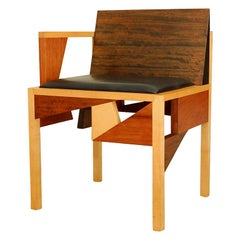 Robert Wilhite mix wood and leather one  arm chair,signed,studio