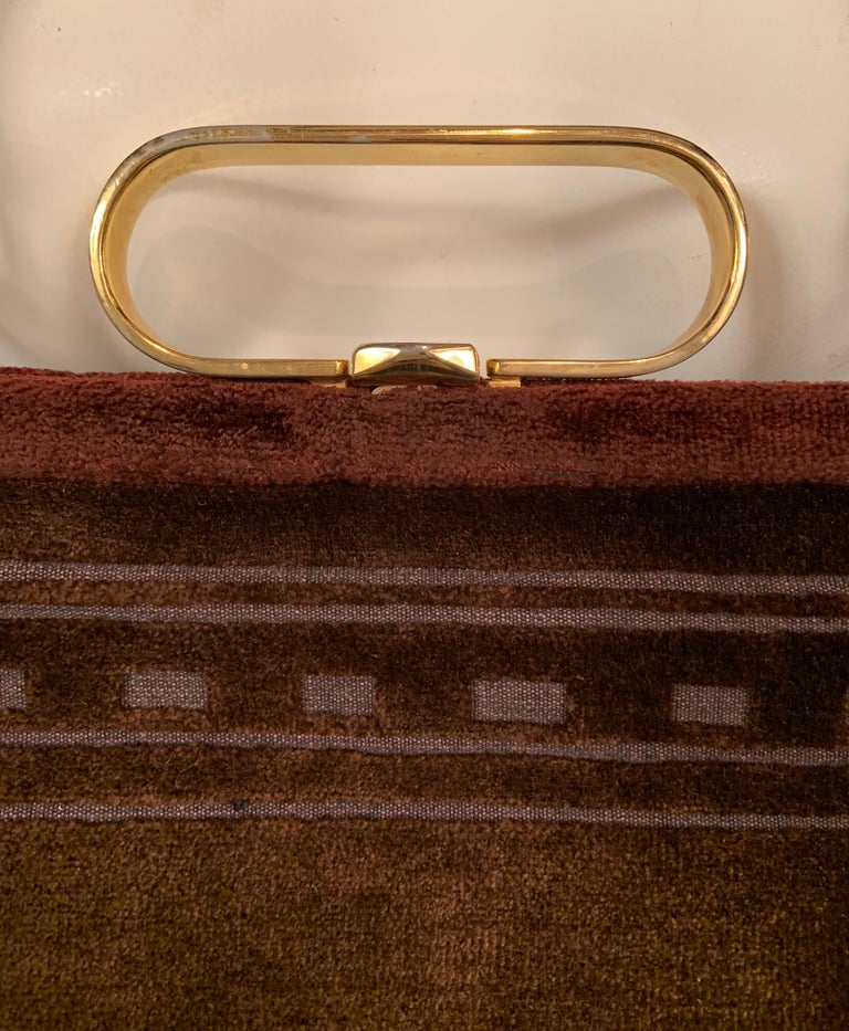 This amazing bag can be worn in three different ways, as a clutch, a top handle bag with the chic brass handle or as a shoulder bag or cross body bag using the velvet strap. That is good design and tremendous versatility. The brown velvet bag has a