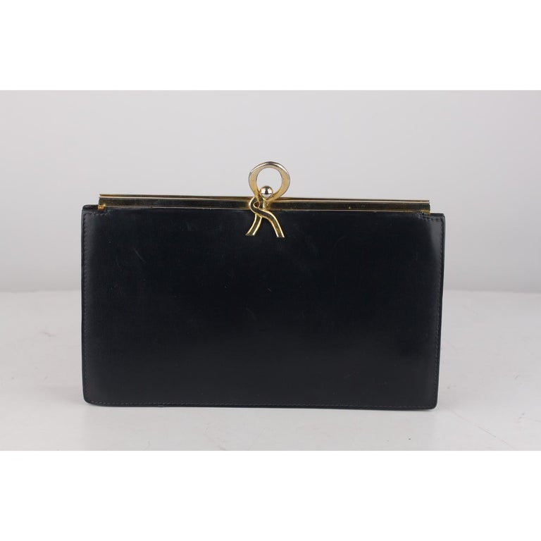 0d36b0782aa Vintage ROBERTA DI CAMERINO navy blue leather clutch bag. Gold metal frame  with R-