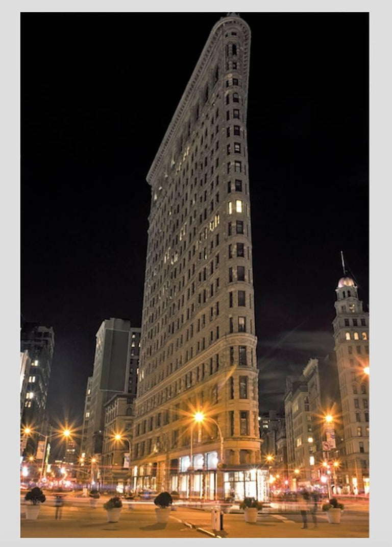 In vibrant rainbow colors from warm-toned to fluorescent, the contemporary color photographs of the Flatiron Building in New York City are in a night photography series. The colorful landscape photographs are in editions of 10 and are available in 5