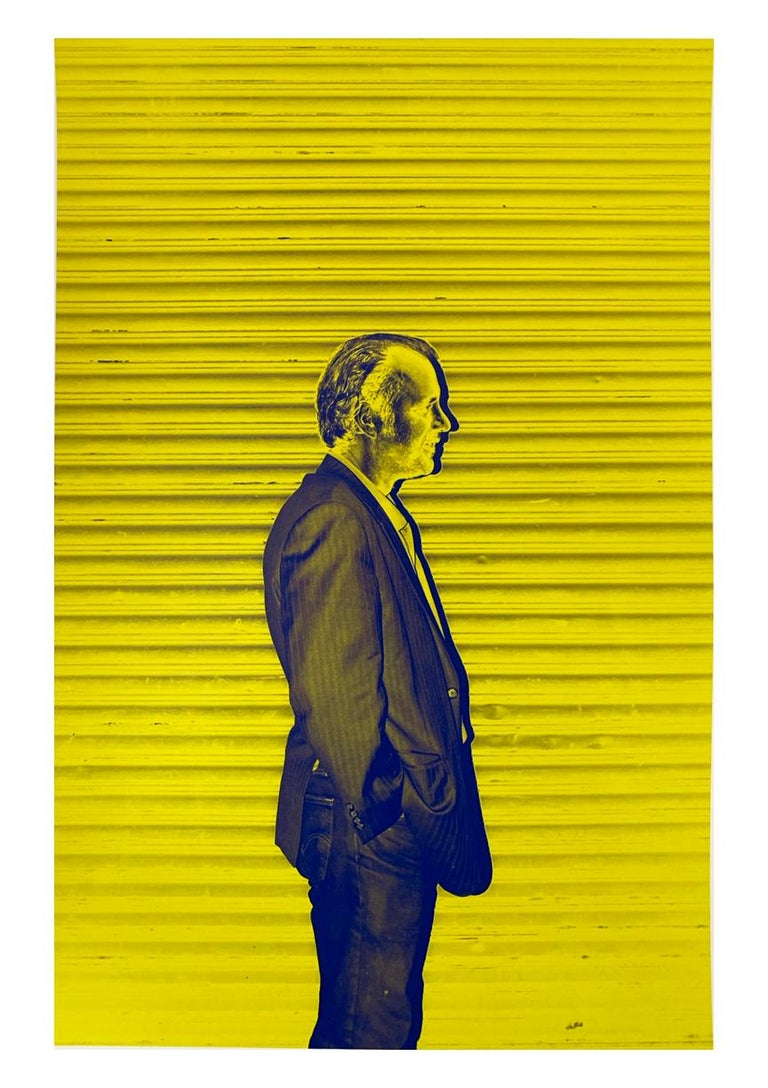 """A neon-yellow contemporary portrait, Modern Man by Roberta Fineberg was shot on the streets of East Harlem, New York.   Modern Man, 2011 by Roberta Fineberg is a 14"""" x 11"""" c-print. The photographer dated, titled, and signed the work on verso (back"""