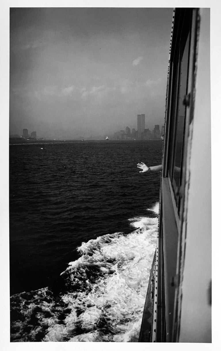 Roberta Fineberg Black and White Photograph - Wave Goodbye, on the Staten Island Ferry, New York City Waterfront