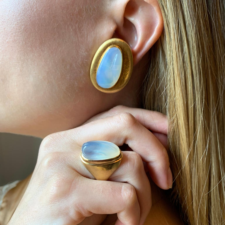 A pair of forma livre carved moonstone and 18 karat yellow gold clip on earrings by Roberto and Haroldo Burle Marx, c. 1970.   The earrings are signed Burle Marx. Stamped 750, IND Bras, GB791.
