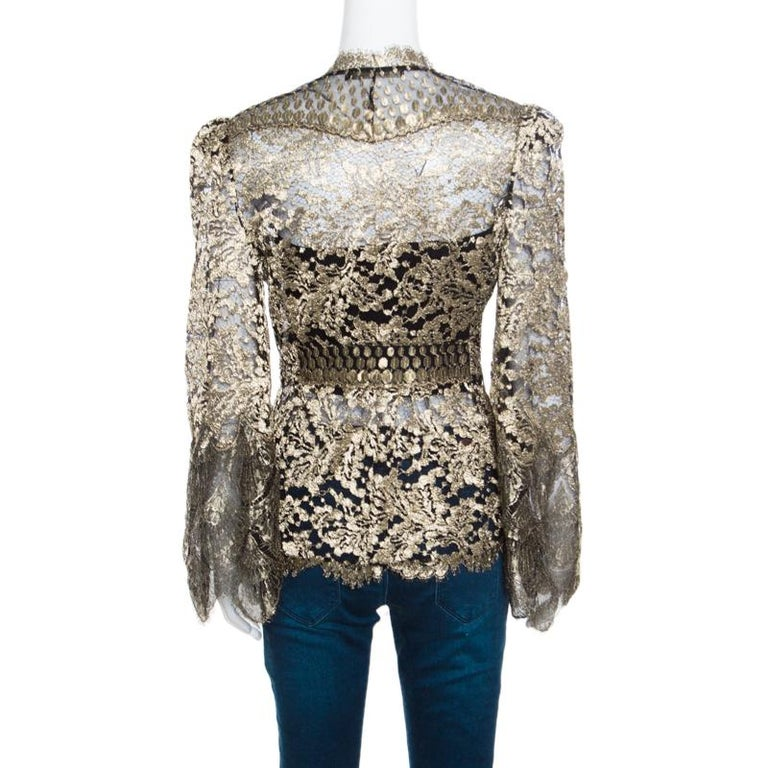 Roberto Cavalli brings you this gorgeous jacket to help you win compliments wherever you go! Shimmering in black and gold, it features a beautiful floral lace design and flaunts scalloped trimmed edges. It comes equipped with front hook fastenings