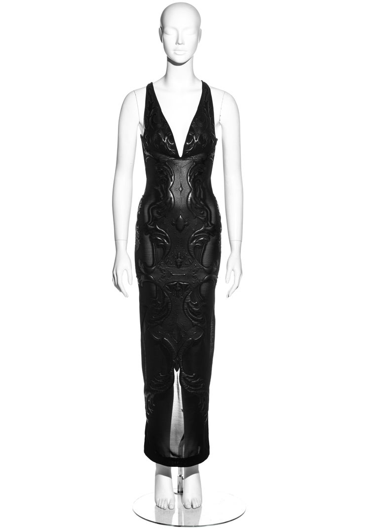 ▪ Roberto Cavalli nylon mesh evening dress ▪ Quilted leather appliques  ▪ Low plunge neckline  ▪ Low back  ▪ Criss-cross shoulder straps  ▪ Size 'XS' (Runs bigger) ▪ Fall-Winter 2002