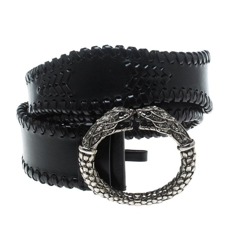 Accessorise right with this belt from Roberto Cavalli. It has been crafted in Italy from black leather and styled with braid details and a serpent buckle in silver tone. This piece can be worn with your casuals.  Includes: The Luxury Closet