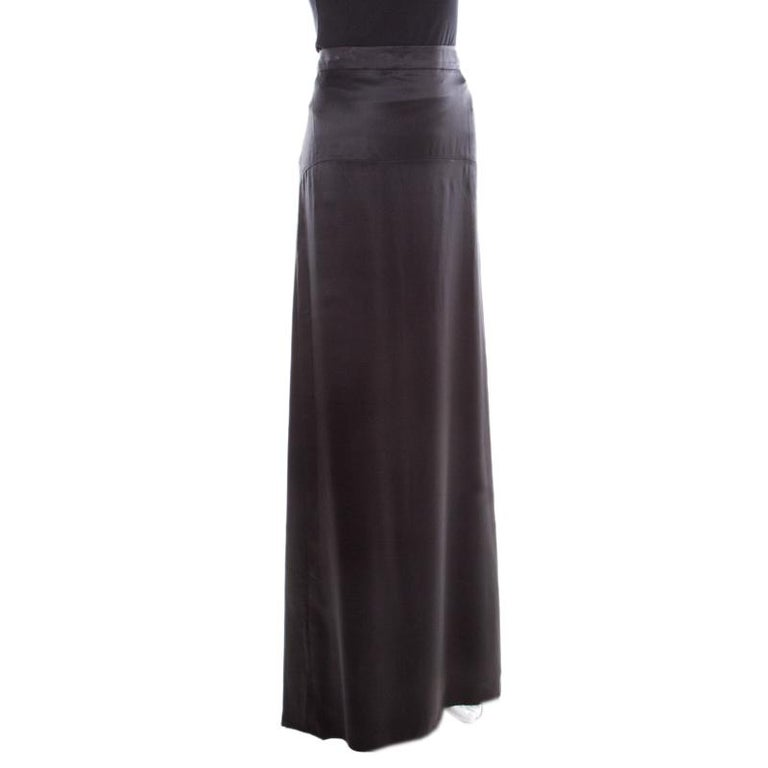 From Roberto Cavalli comes this maxi skirt crafted in a straight silhouette with flattering floor-sweeping length. It is adorned with a classic black hue and features a subtle pleat detail at the bottom rear. It is crafted from silk and will look
