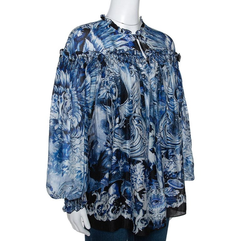Roberto Cavalli is known to create unique prints and vibrant colors that flatter. This blouse is perfect for fun days and will lift your casual outfits instantly. Crafted from pure silk, it comes in a shade of blue and has a lovely print throughout.