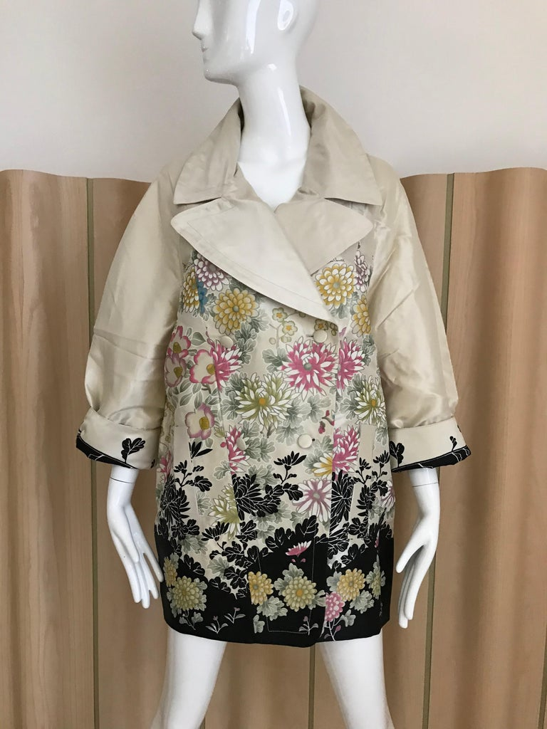 Roberto Cavalli Silk Creme coat with multi color floral prin in pink, green, Creme and yellow. Coat is brand new with Tag. Size: 38italy  Coat Length: 34