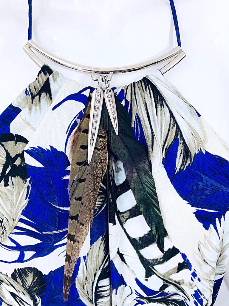 Sexy early 2000s ROBERTO CAVALLI feathers and rhinestones viscose jersey handkerchief hem halter dress! Features bright cobalt blue mixed with white and black throughout. Real feathers at center neck with silver rhinestone encrusted pendants at