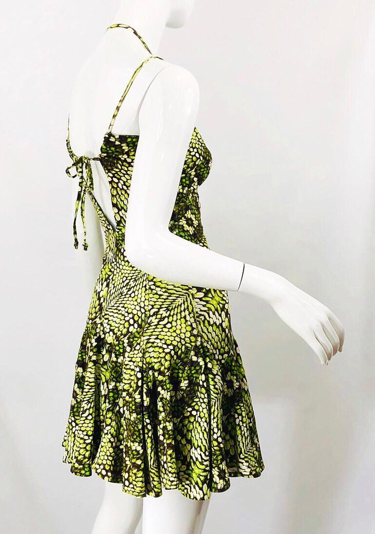 Sexy early 2000s ROBERTO CAVALLI neon green, black and white reptile print. Flirty skater style with a slight drop waist. Brass metal loop at center bust. Ties at center back to accomodate an array of bust sizes. Soft Cotton (89%) and Elastane (11%)