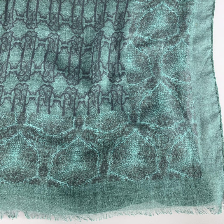 ROBERTO CAVALLI scarf comes in green cashmere blend with an all over snake and interlock print with fringed edges. Made in Italy.  Excellent Pre-Owned Condition.  67 x 27.5 in.