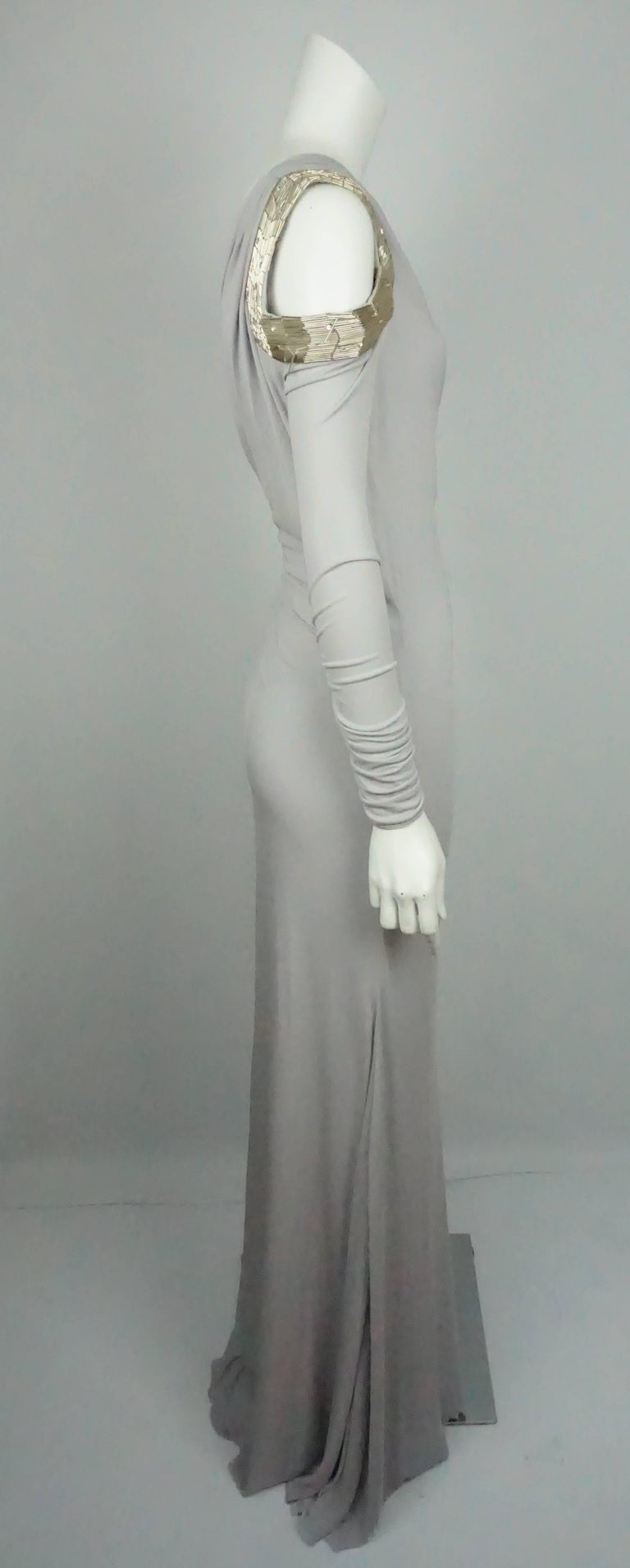 Roberto Cavalli Grey Silk Jersey One Shoulder Beaded Gown - 42  This beautiful gown is in good condition. The dress is made of a poly-blend material and is lined in silk. The dress is a one shoulder that is long sleeve and has a ruching detail on