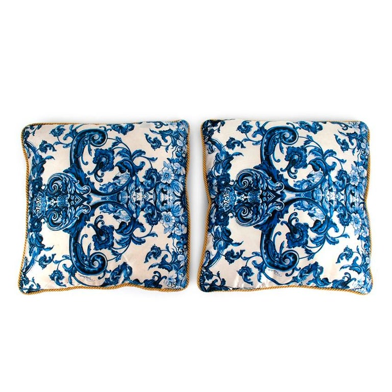 Roberto Cavalli Home Blue Silk Tile Print Set of 2 Cushions  -Luxurious super soft silk satin texture  -Gorgeous opulent tile like motif  -Golden cord pipping  -Zip fastening to the bottom  -Branding to the pattern  -Elegant timeless style