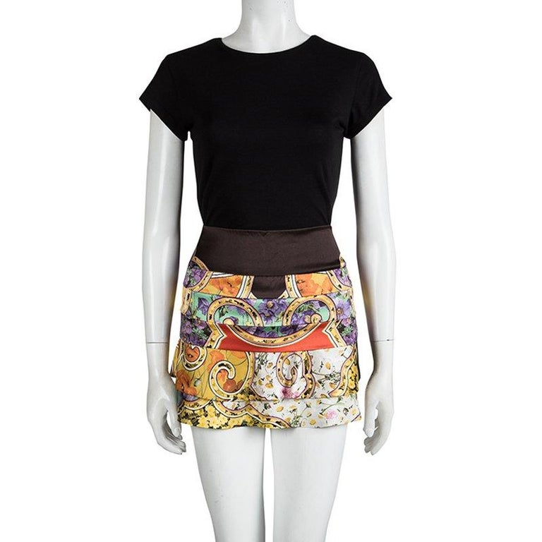 Roberto Cavalli's multicolour floral mini skirt is made dramatic and chic with the tiered layers on the skirt for an added drama. The high hemline makes it sleek enough for evening, while the modern design can be easily dressed down for day with a