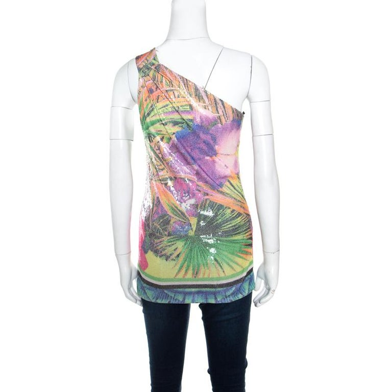 Cut to a stylish silhouette with one shoulder design; this Roberto Cavalli top is perfect for your after-dark adventures. It is stunningly embellished with sequins and features a multicoloured floral print all over. The top will work best with