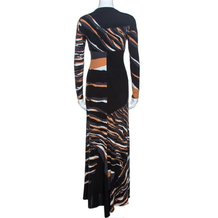 This lovely maxi dress comes from the house of Roberto Cavalli. Crafted from quality materials, it flaunts a multicolored print throughout. It is styled to deliver comfort and effortless style. It comes with a deep v-neck, long sleeves, a