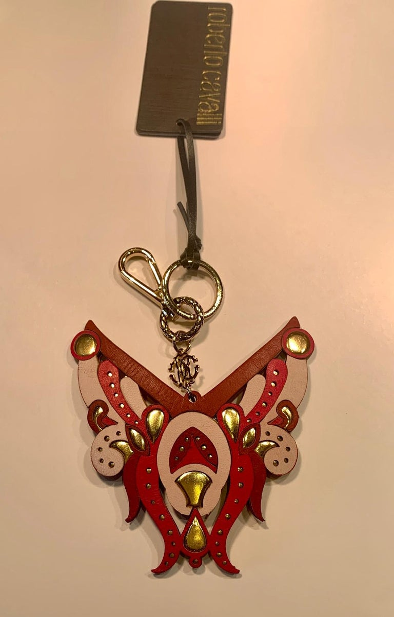 Striking and unusual, hand made in Italy, designer Roberto Cavalli, leather key holder, key chain, or purse charm in beautiful shades of pink and metallic gold.  Accent that special purse to make it stand out or just use it for your keys. Very