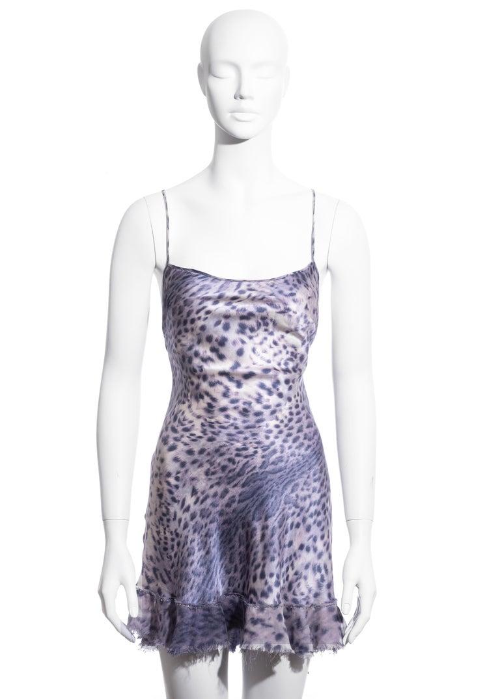 ▪ Roberto Cavalli purple leopard print mini dress ▪ 100% Silk ▪ Cowl neckline ▪ Criss-cross string back fastening ▪  Frayed hemline edged with gems  ▪ Size: Extra Small (would fit bigger sizes) ▪ Spring-Summer 1999