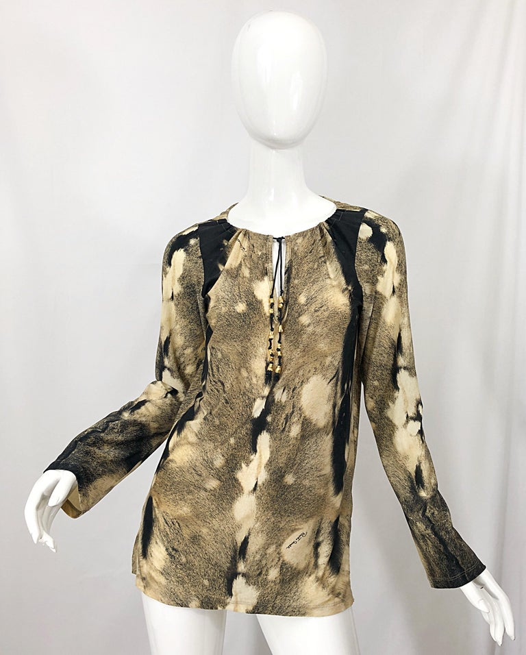 Awesome vintage late 1990s ROBERTO CAVALLI trompe l'oeil faux fur print brown and ivory tunic shirt! Features a warm brown and ivory print throughout. Soft stretch jersey offers a flattering comfortable fit. Gold beaded tassels at center neck. Side