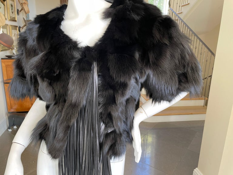Roberto Cavalli Vintage Black Fox Fur Bolero Jacket with Leather Fringe Please use the zoom feature to see all the great details. Size 42 Bust 38