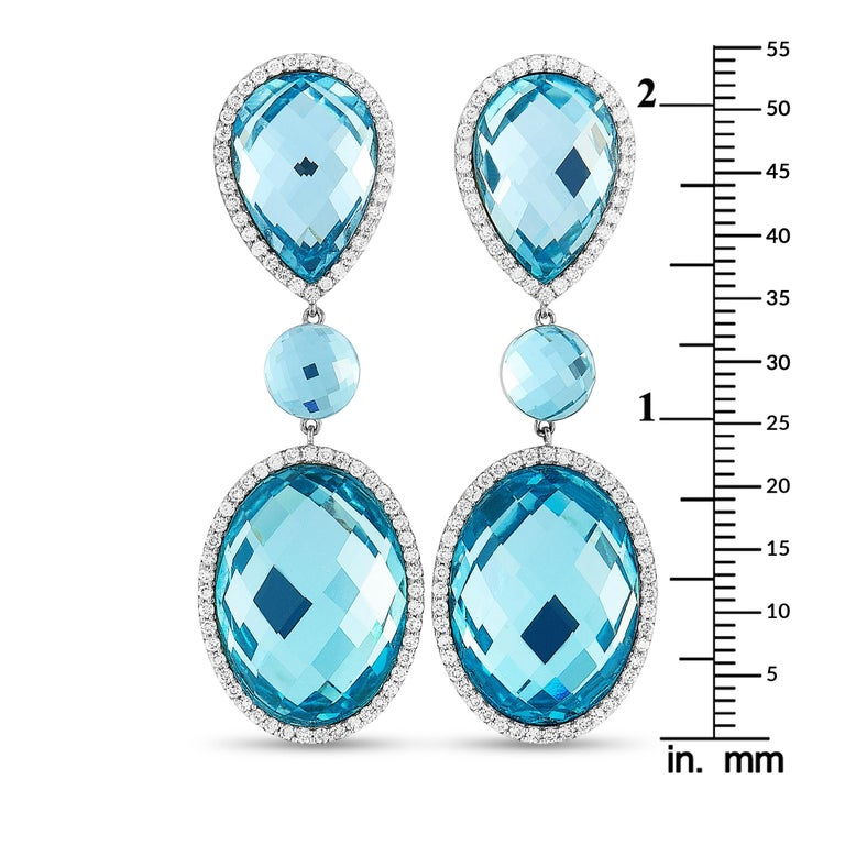 """These Roberto Coin earrings are made of 18K white gold and each weighs 12.25 grams, measuring 2.20"""" in length and 0.75"""" in width. The earrings are set with diamonds and topazes that total 1.32 and 30.00 carats respectively.  Offered in brand new"""